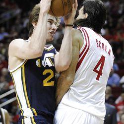 Utah Jazz's Gordon Hayward (20) is fouled by Houston Rockets' Luis Scola (4).