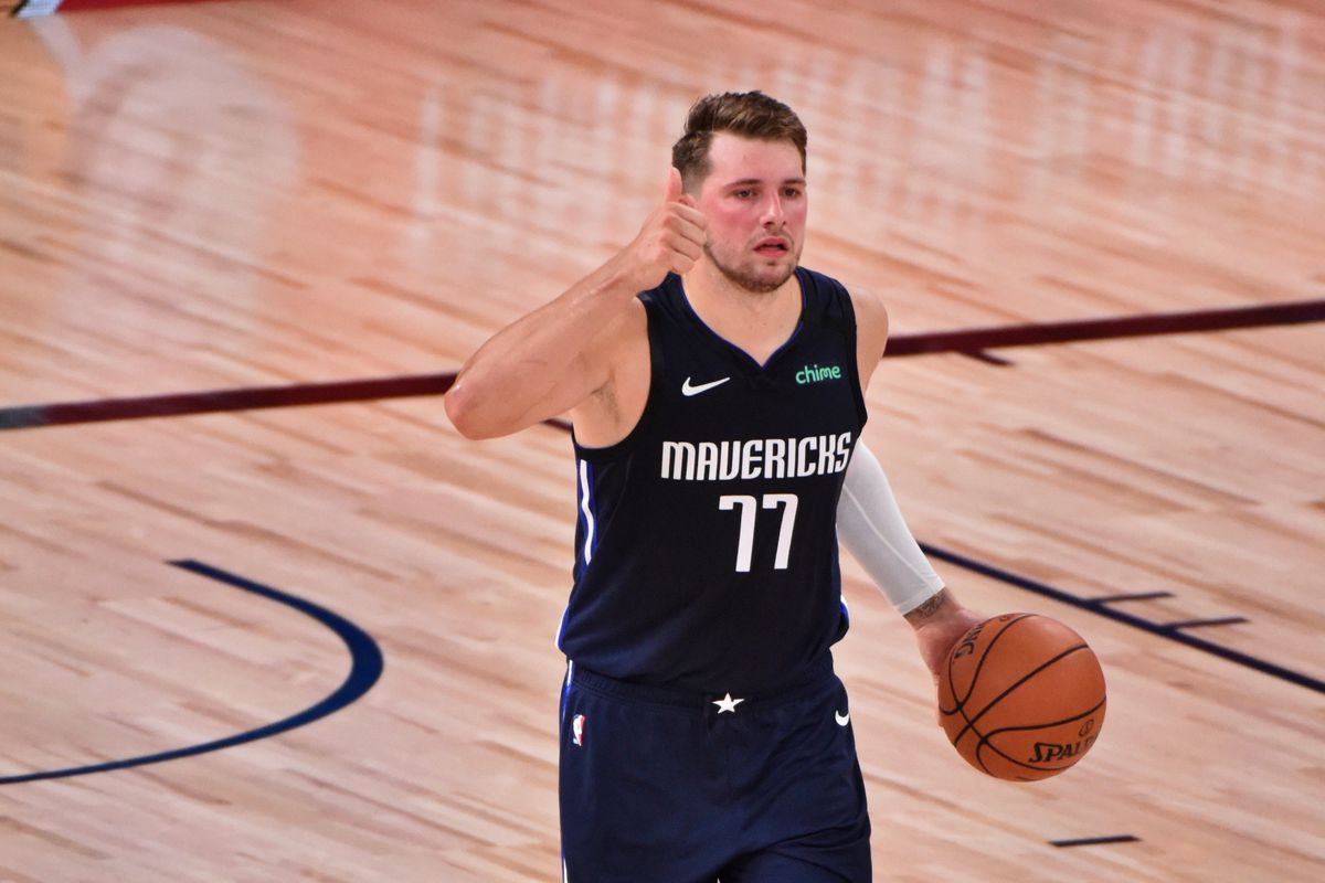 Luka Doncic of the Dallas Mavericks handles the ball against the LA Clippers during Round One Game Four of the NBA Playoffs on August 23, 2020 at The AdventHealth Arena at ESPN Wide World Of Sports Complex in Orlando, Florida.