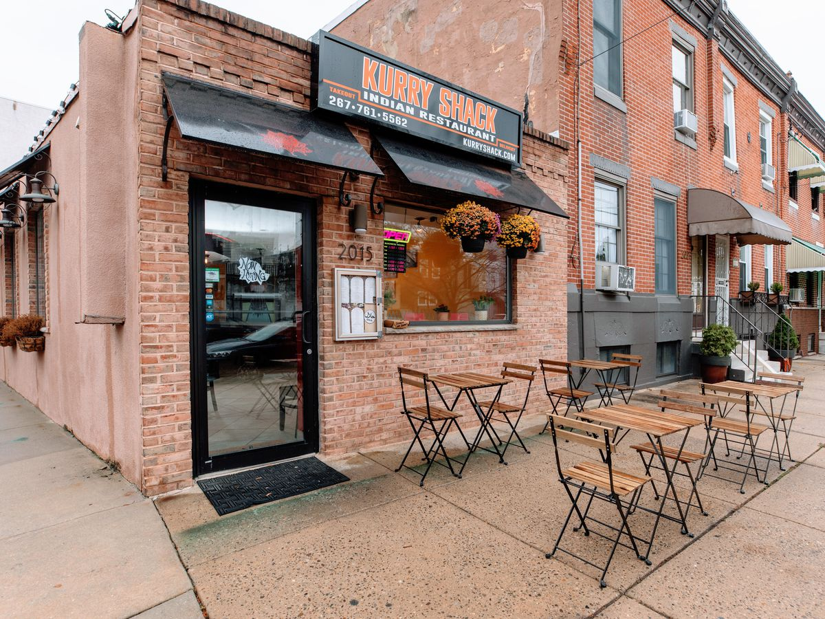exterior of small restaurant with sidewalk tables