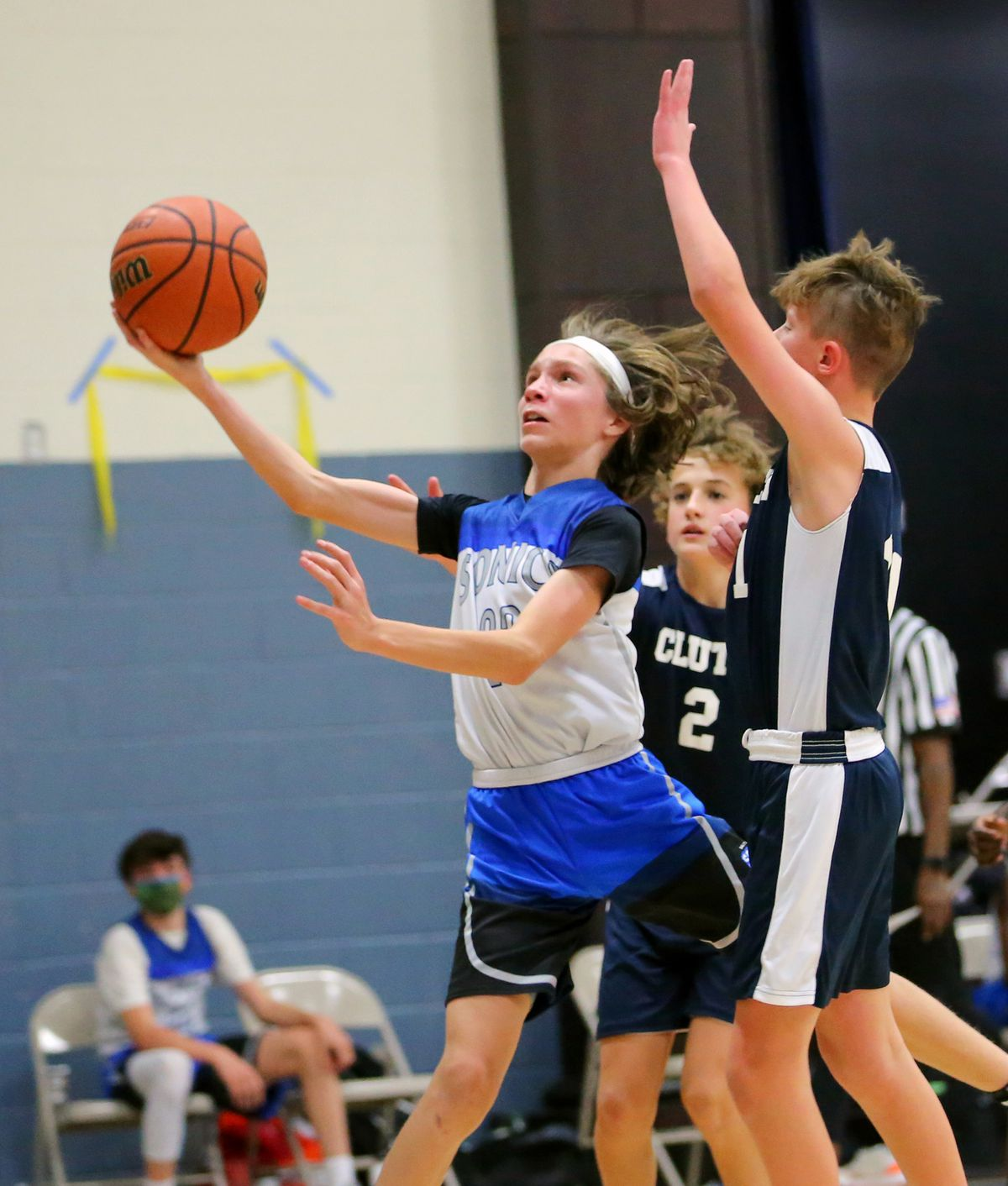 Kai Flickinger pushes up the ball for a shot as he and his teammates on the Sonics play Clutch in a youth basketball game at Providence Hall Junior High in Herriman Utah on Saturday, Dec. 19, 2020.