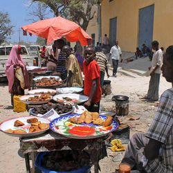 In this photo taken Thursday, March 29, 2012, Somali vendors sell street food at the Hamarweyne market in Mogadishu, Somalia. The seaside capital of Mogadishu is full of life for the first time in 20 years after African Union and Somali troops pushed Islamist militants out of the city last year.