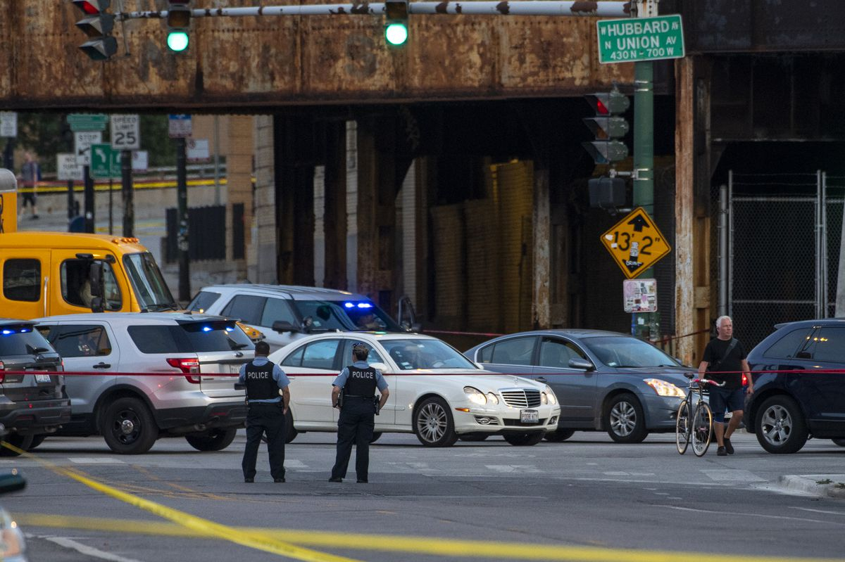 Chicago Police are working at the scene where several people were shot near the intersection of Grand Avenue, Halsted Street and Milwaukee Avenue in the West Town neighborhood on Wednesday, September 29, 2021.