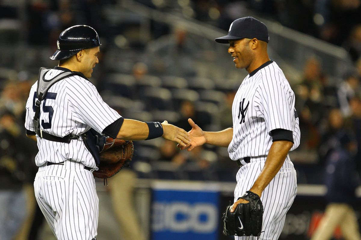 Mariano Rivera and Russell Martin of the New York Yankees celebrate a 2-1 victory against the Baltimore Orioles. It might be the last time they get to do so. (Photo by Al Bello/Getty Images)