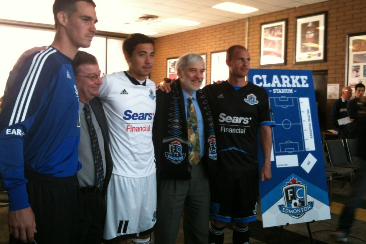 FC Edmonton's Chris Kooy, John Smits, and Matt Lam modeling their new jerseys with owner Tom Fath. (Image by FC Edmonton)