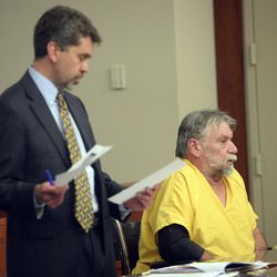 """Defense attorney Mike Sikora, left, addresses the court as Patrick Michael McCabe, 60, listens to the proceedings during McCabe's sentencing before 3rd District Judge Paul Parker in Salt Lake City on Wednesday, June 7, 2017. McCabe pleaded guilty to first-degree felony counts of murder and aggravated burglary in the December 1977 slaying of 16-year-old Sharon """"Lecia"""" Schollmeyer at her Salt Lake apartment."""