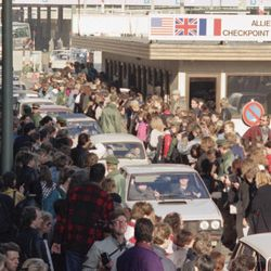 East German citizens are applauded by West Berliners when they cross Checkpoint Charlie with their cars to visit West Berlin, Nov. 10, 1989. Thousands of East Germans moved into West Berlin after the opening of the wall by East German government. Monday, Nov. 9, 2009 marks the 20th anniversary of the fall of the Berlin Wall. (AP Photo/Thomas Kienzle)