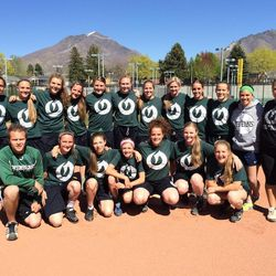 The Olympus softball team poses for a picture before practice Monday. They have been selling iPhone cases to raise money for teammate Reagan Everett, who is battling brain cancer. The Titans will also host Bountiful in a purple game on April 25 to raise more money for the Everett family and show support for Reagan.