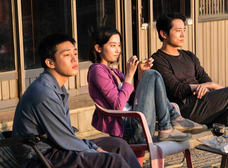 Yeun with his costars Ah-In Yoo andJong-seo Jeon in Burning.