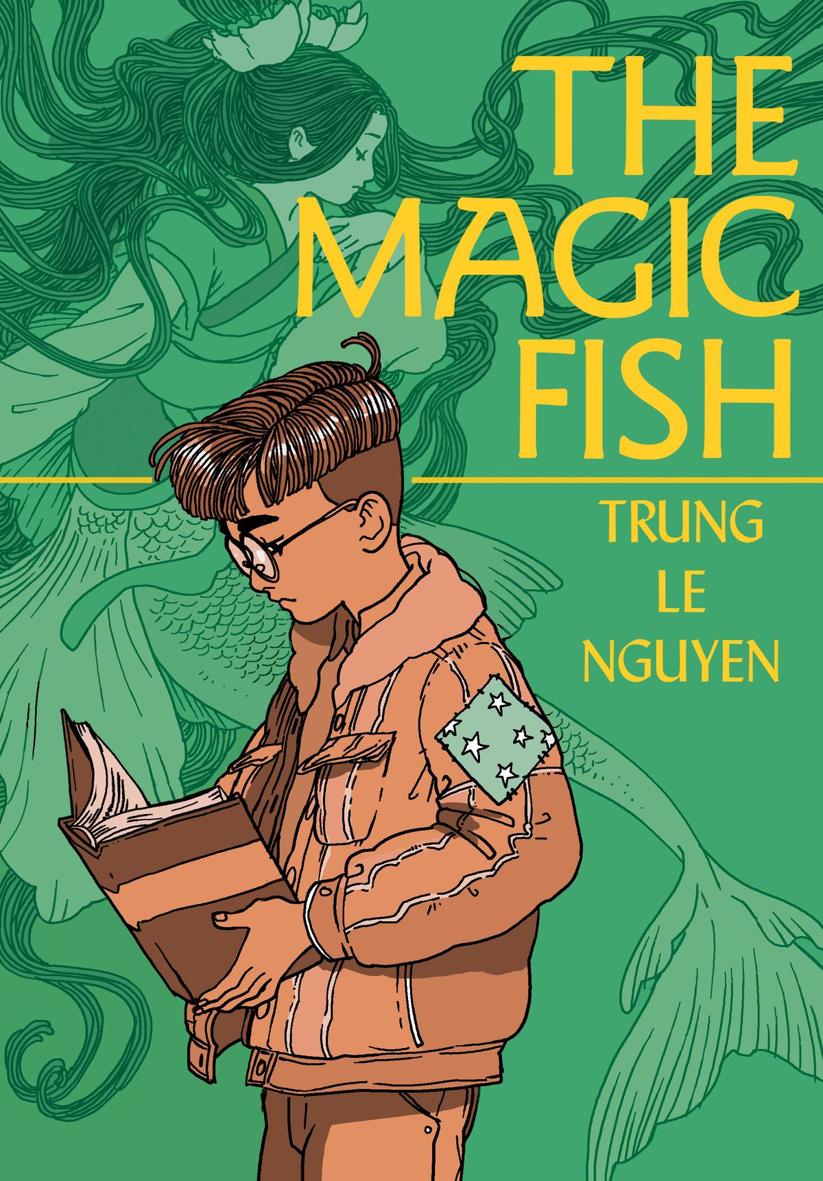 Tiến, a young Vietnamese-American boy, reads a book on the cover of The Magic Fish (2020).