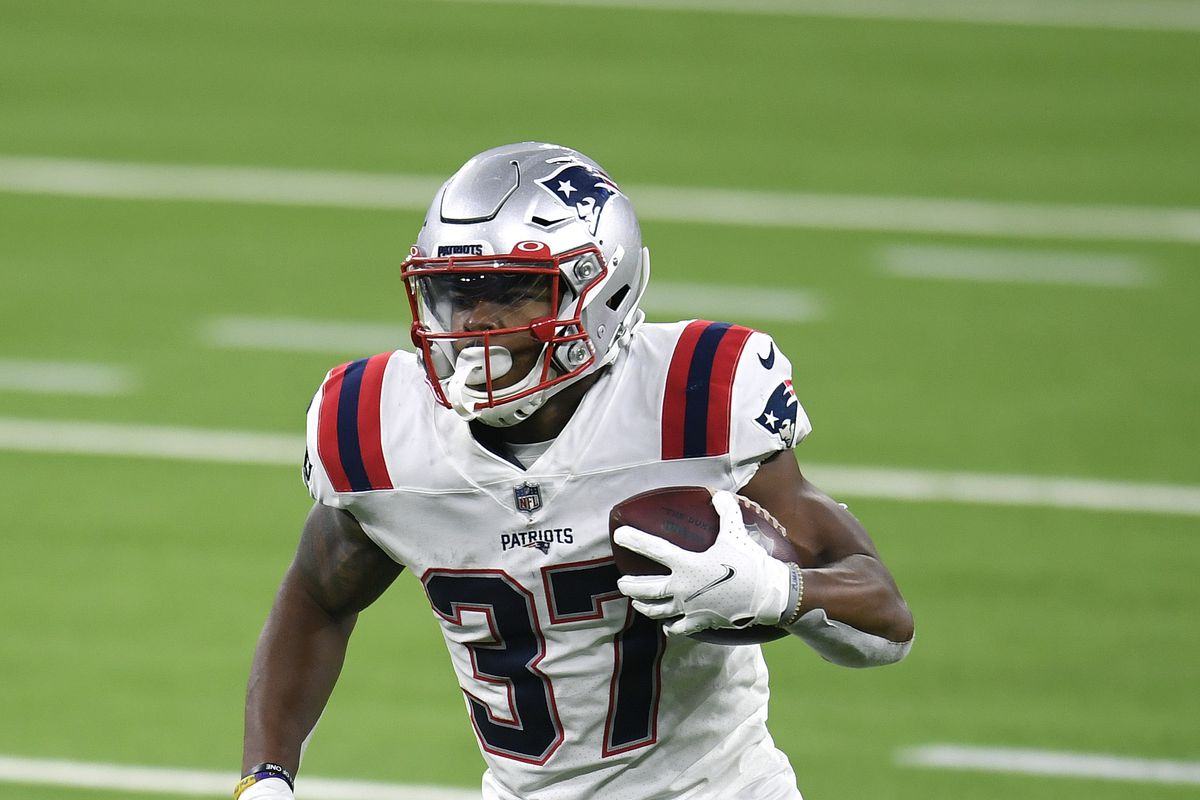 Damien Harris #37 of the New England Patriots runs with the ball during a 24-3 Los Angeles Rams win at SoFi Stadium on December 10, 2020 in Inglewood, California.