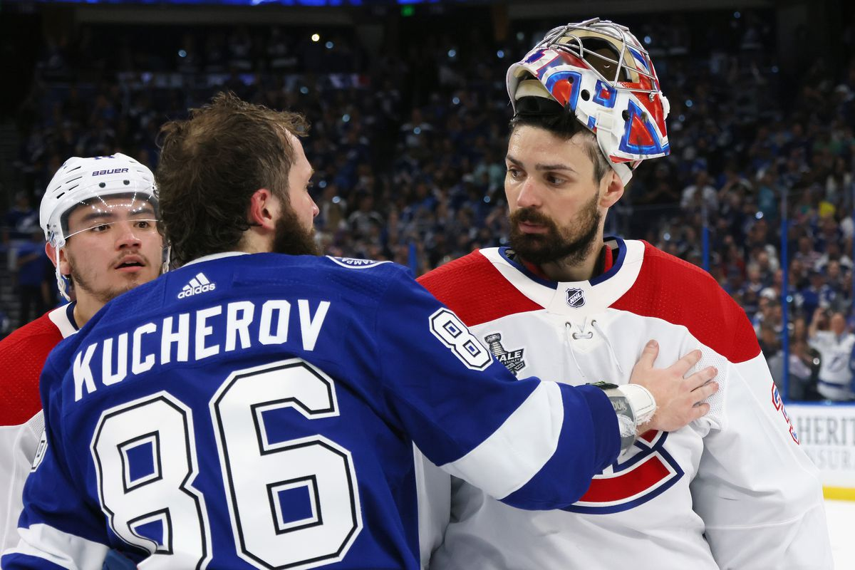 Carey Price #31 of the Montreal Canadiens and Nikita Kucherov #86 of the Tampa Bay Lightning shake hands following the Lightning's victory over the Montreal Canadiens in Game Five of the 2021 NHL Stanley Cup Final at the Amalie Arena on July 07, 2021 in Tampa, Florida. The Lightning defeated the Canadiens 1-0 to take the series four games to one.