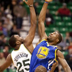Jazz center Al Jefferson (25) and Warriors center Festus Ezeli (31) go up for the opening tip during the NBA basketball game between the Utah Jazz and the Golden State Warriors at Energy Solutions Arena, Wednesday, Dec. 26, 2012.