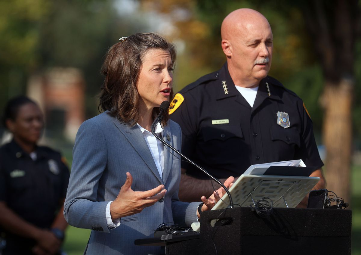 Salt Lake City Mayor Erin Mendenhall, left, talks about the city's crime rates while standing next to Salt Lake Police Chief Mike Brown during a press conference at Pioneer Park on Tuesday.