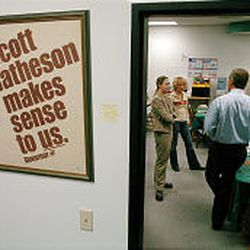 Jim Matheson talks with campaign staffers in his re-election campaign office recently. The campaign poster on the wall is from the successful 1976 gubernatorial race of his father, Scott M. Matheson Sr.