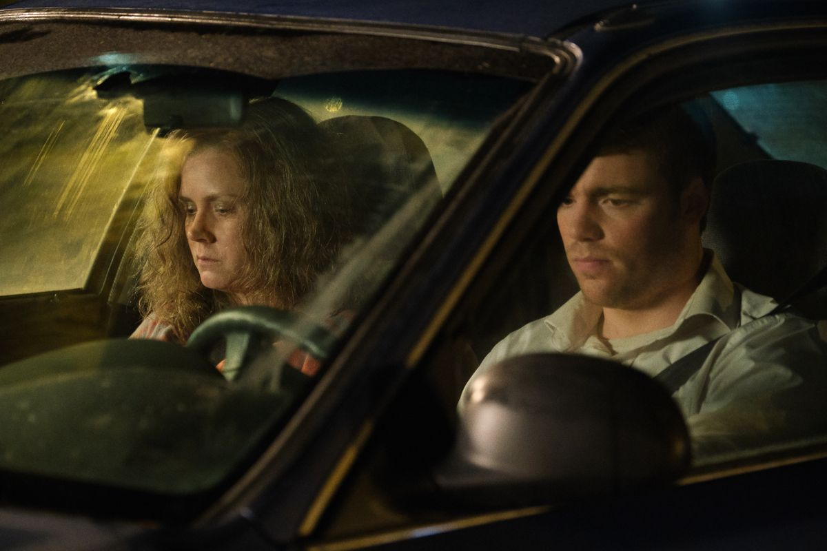 Amy Adams and Gabriel Basso sit sullenly in a car together in Hillbilly Elegy