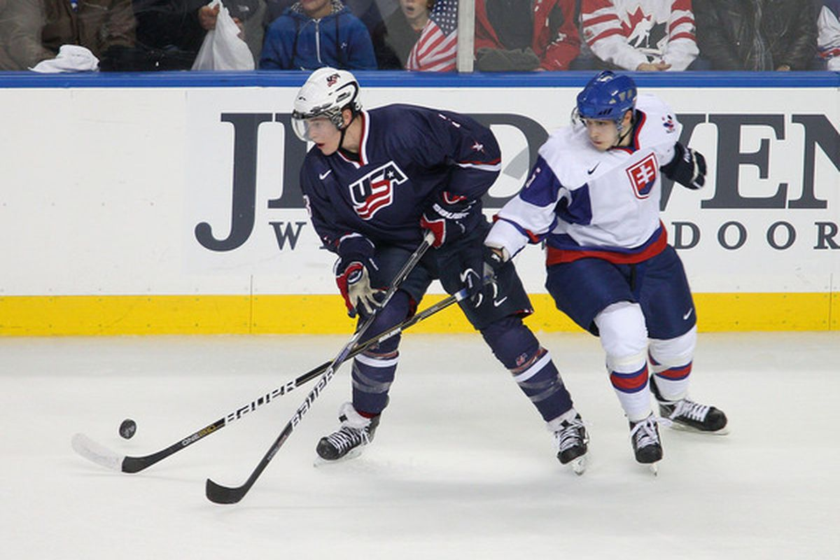 Wait... why is a Wild prospect wearing a USA jersey? Mind = blown.