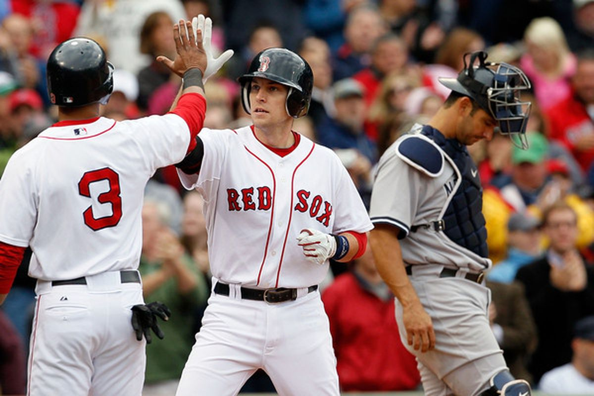 BOSTON - OCTOBER 3:  Jed Lowrie #12 of  the Boston Red Sox crosses home after hitting a home run against the New York Yankees at Fenway Park October 3 2010 in Boston Massachusetts. (Photo by Jim Rogash/Getty Images)