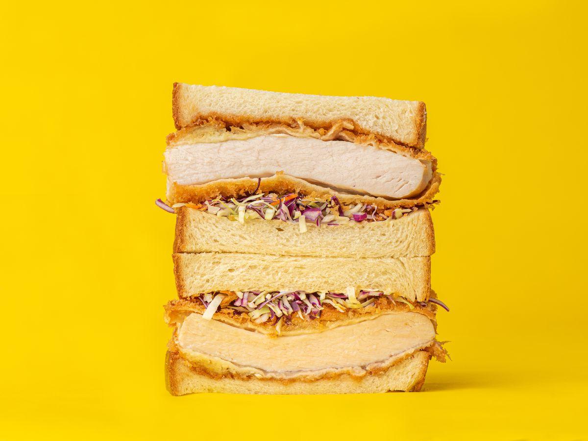 Katsu sando on a yellow background.