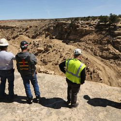 Workers watch drilling and blasting at the Bronco Utah Mine near Emery on Wednesday, March 29, 2017.