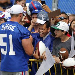 Zad DeOssie interacts with the fans. [Jim O'Connor-USA TODAY Sports]