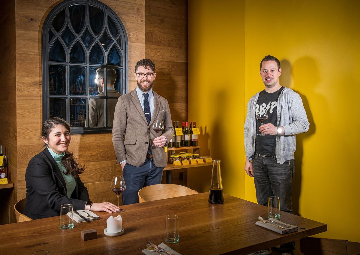 Albi's wine team of head sommelier Vanessa Cominsky, beverage director William Simons, and co-owner Brent Kroll pose for a portrait