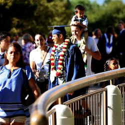 Brigham Young University's Class of 2015 leaves the Marriott Center after commencement exercises in Provo on Thursday, Aug. 13, 2015.