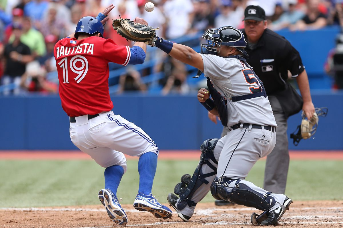 Jose Bautista scores as Pena can't handle the throw