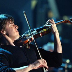 Violin virtuoso Joshua Bell was enthusiastically welcomed to Brigham Young University's de Jong Concert Hall stage and had his nearly sold-out audience hanging on every note Thursday night. Bell is pictured here in 2002 performing at the Grammy Awards in Los Angeles.