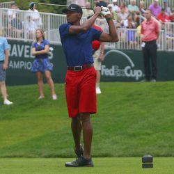 Ray Allen watches his drive on the first hole.