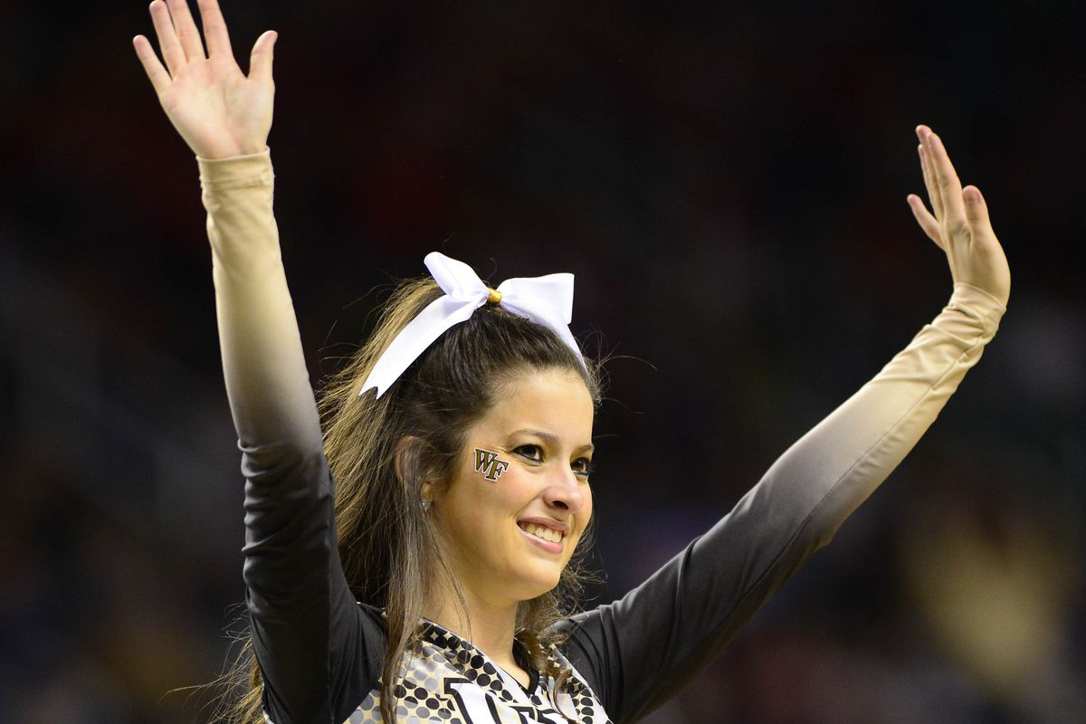 A Wake Forest cheerleader in action at the 2013 ACC Tournament
