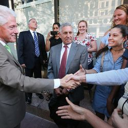 Former President Bill Clinton greets supporters after a roundtable meeting with business leaders at the One Utah Center in Salt Lake City on Thursday, Aug. 11, 2016.