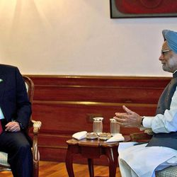 Pakistan President Asif Ali Zardari, left, talks with Indian Prime Minister Manmohan Singh during their meeting at the latter's residence in New Delhi, India, Sunday, April 8, 2012. Zardari arrived in India on a private trip Sunday that also gives him a chance to meet Indian leaders amid a thaw in relations between the two South Asian rivals.