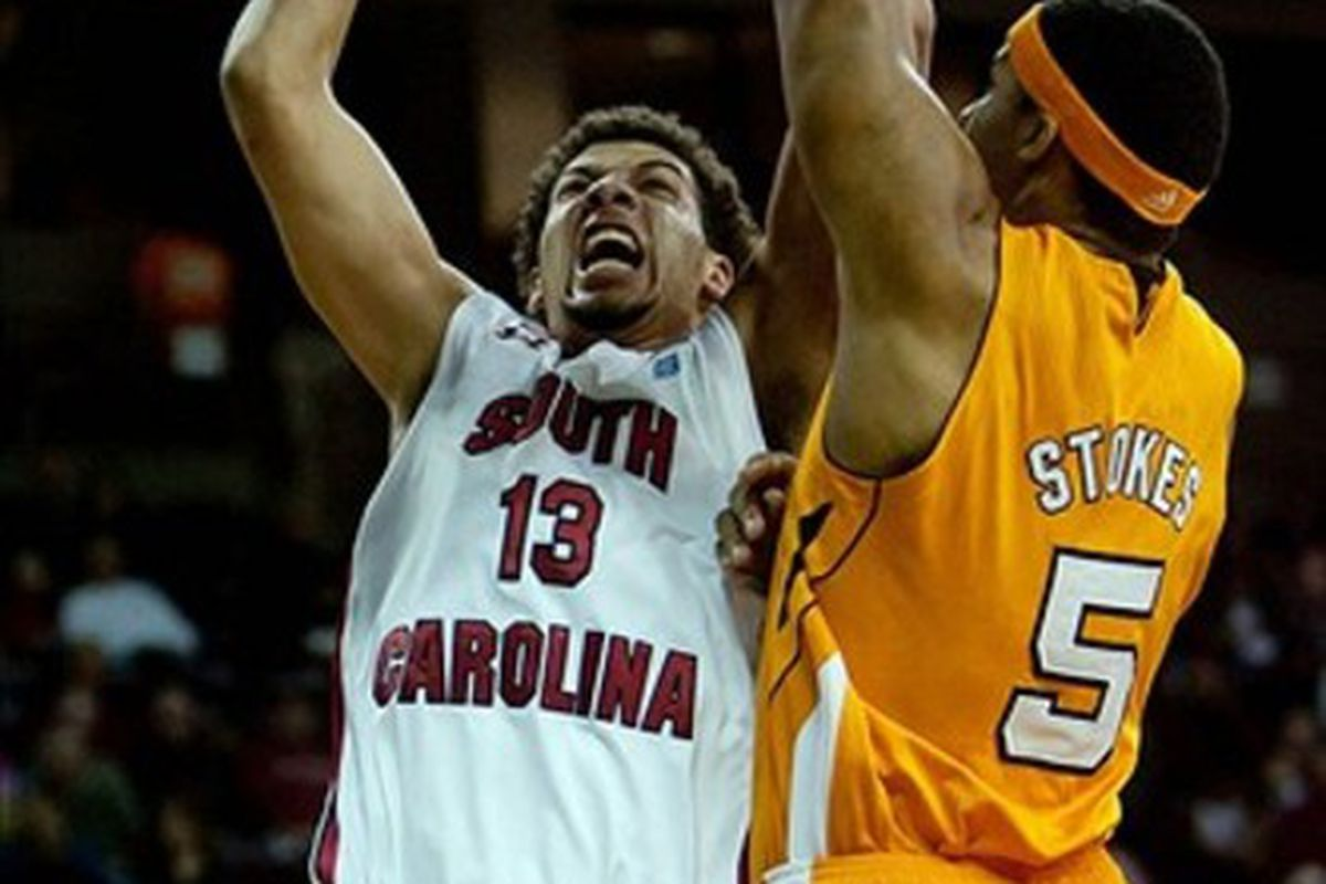 February 25, 2012; Columbia, SC, USA; South Carolina Gamecocks forward Anthony Gill (13) shoots over Tennessee Volunteers forward Jarnell Stokes (5) in the first half at Colonial-Life Arena. Mandatory Credit: Jeff Blake-US PRESSWIRE