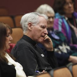 Father George Horan, second from left, listens as members of public testify on proposed regulations to use a single lethal drug for the execution of condemned inmates, during a public hearing by the California Department of Corrections and Rehabilitation, Friday, Jan. 22, 2016, in Sacramento, Calif.  Horan, a death penally opponent, spoke against the use of the single injection of  powerful barbiturates in executions that would replace the series of three drugs used in California's last execution, of Clarence Ray Allen in 2006.(AP Photo/Rich Pedroncelli)