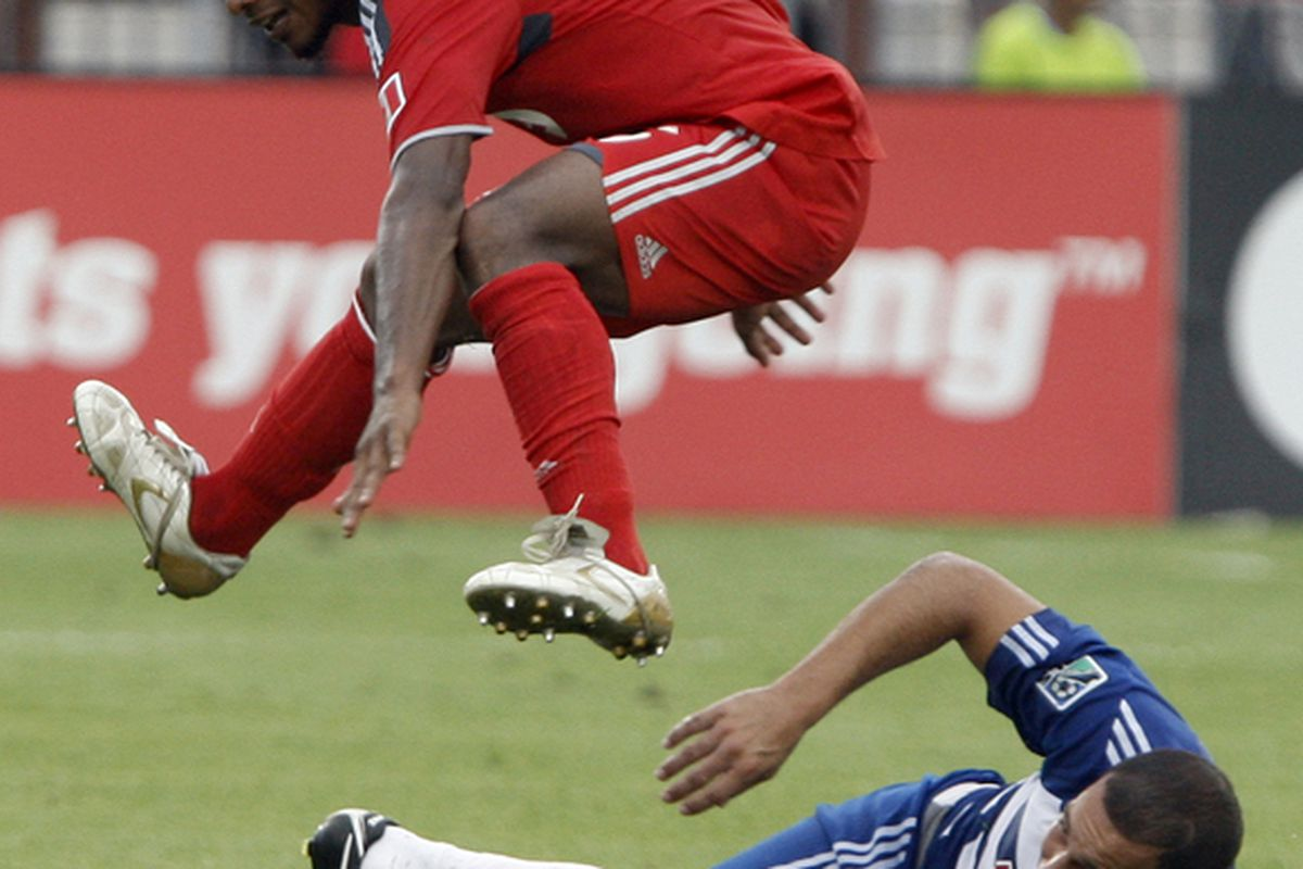 TORONTO - JULY 24: Julian de Guzman #6 of Toronto FC jumps over Milton Rodriguez #7 of FC Dallas at BMO Field during a MLS game July 24 2010 in Toronto Ontario Canada. (Photo by Abelimages/Getty Images)
