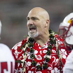 Lamar head coach Ray Woodward speaks to his team during a timeout in the second quarter of the NCAA game between the Lamar and Hawaii, Sept. 15, 2012 in Honolulu.