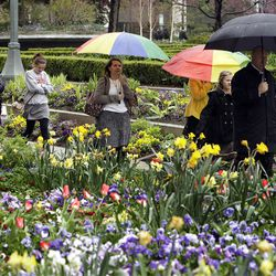 Attendees walks by the flowers during the 182nd Annual General Conference for The Church of Jesus Christ of Latter-day Saints in Salt Lake City  Sunday, April 1, 2012.