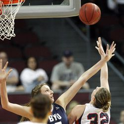 Brigham Young Cougars center Jennifer Hamson (5) defends Gonzaga Bulldogs forward Kayla Standish (32)  in the West Coast Conference finals in Las Vegas  Monday, March 5, 2012.  BYU won the title and will advance to the NCAA tournament.