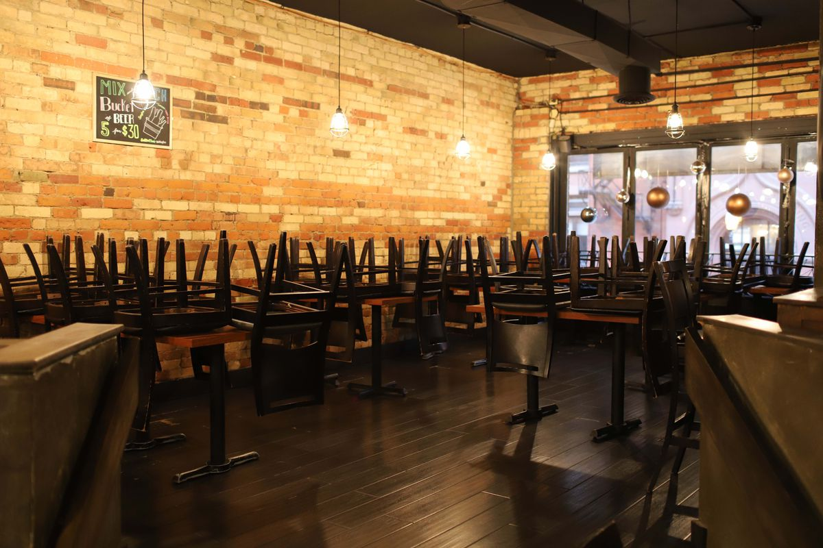empty restaurant with chairs stacked on tables