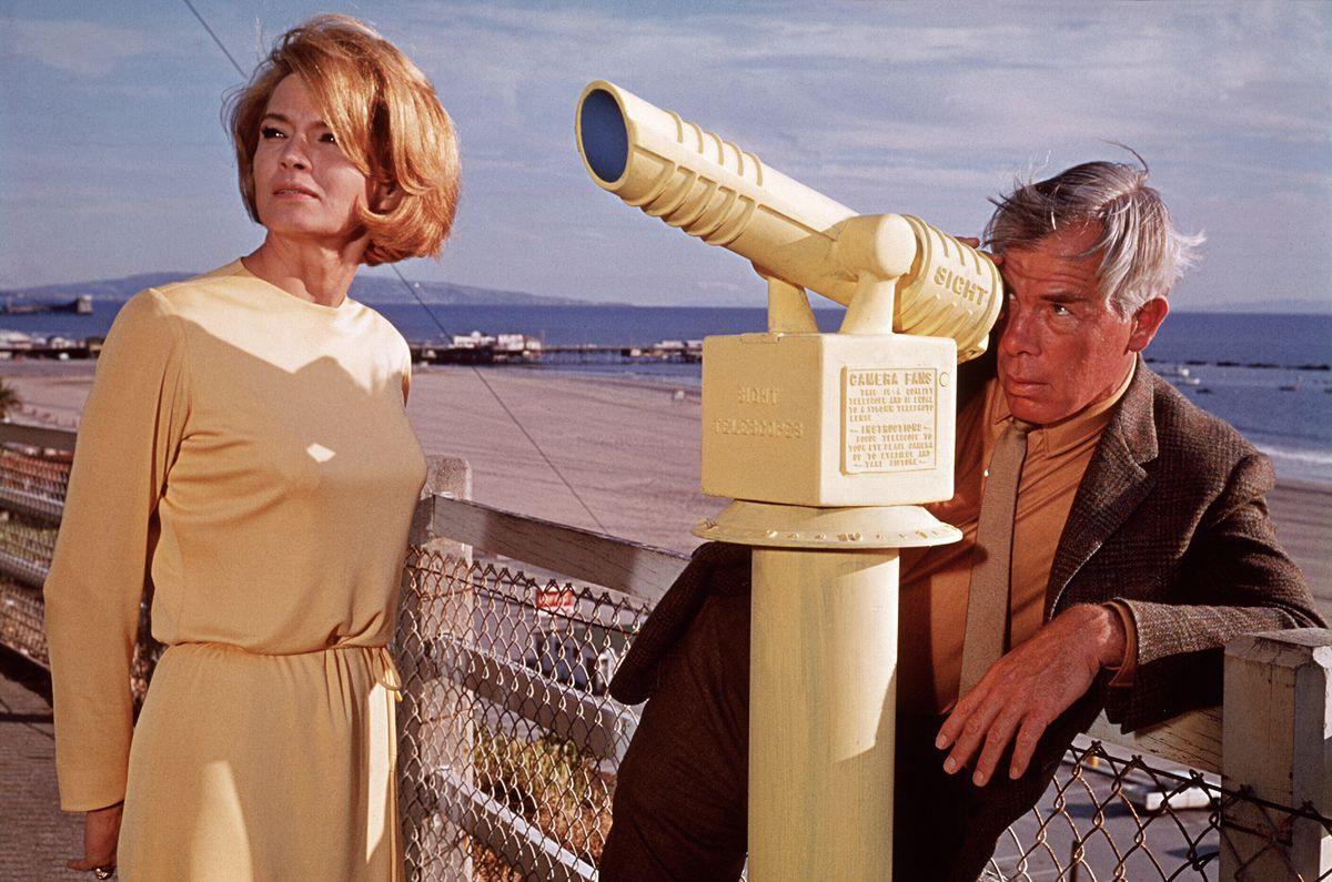 Lee Marvin as Walker peering through a telescope in Point Blank.