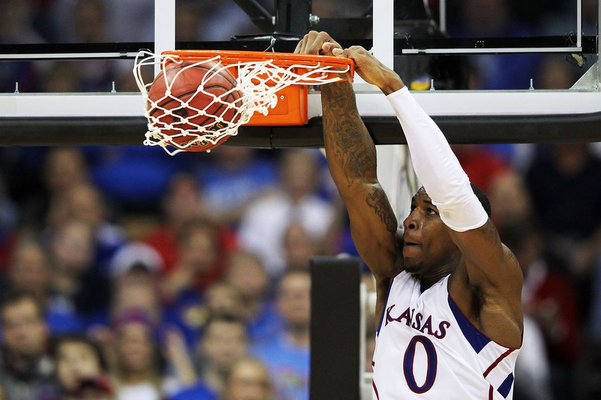 KANSAS CITY, MO - DECEMBER 19:  Thomas Robinson #0 of the Kansas Jayhawks dunks during the game against the Davidson Wildcats on December 19, 2011 at the Sprint Center in Kansas City, Missouri.  (Photo by Jamie Squire/Getty Images)