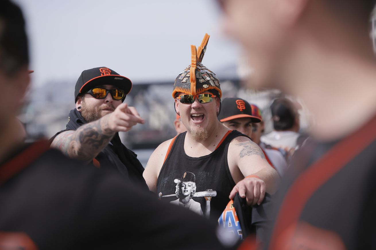 Jeremy Fowler, (left) and Bradley Beede of Fairfield wait for the gates to open, as the San Francisco Giants get set to take on the Los Angeles Dodgers during opening day of the 2016 MLB season, at AT&T Park in San Francisco, California on Thurs. April 7