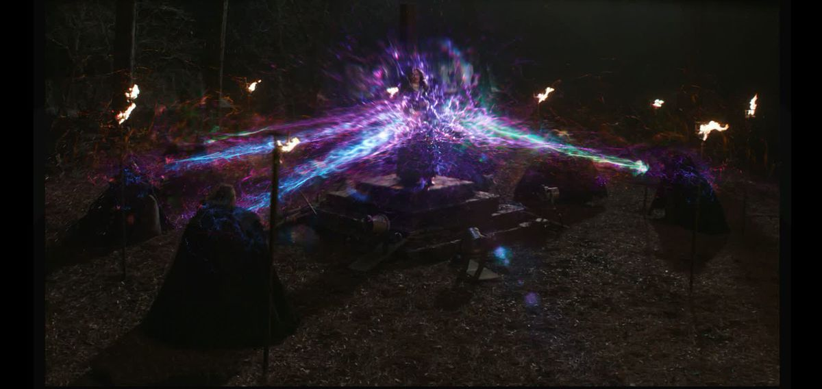 Witches surround Agatha and attack her with bolts of rainbow magic in early concept art for WandaVision