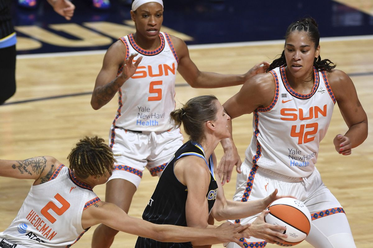 Connecticut Sun guard Natisha Hiedeman (2) commits the foul on Sky guard Allie Quigley as Brionna Jones (42) and Jasmine Thomas (5) help on defense.
