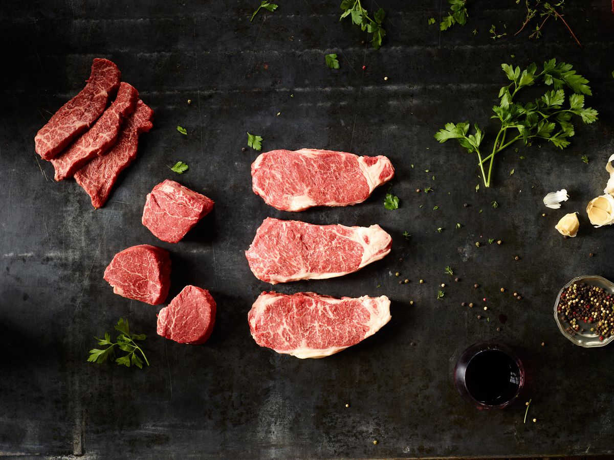 A top-down image of Wagyu beef slices, uncooked.