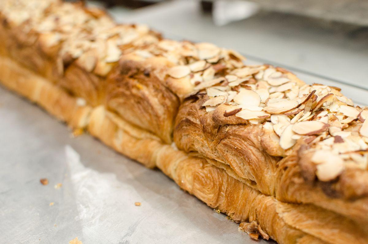 One long loaf of babka, topped with slivered almonds.