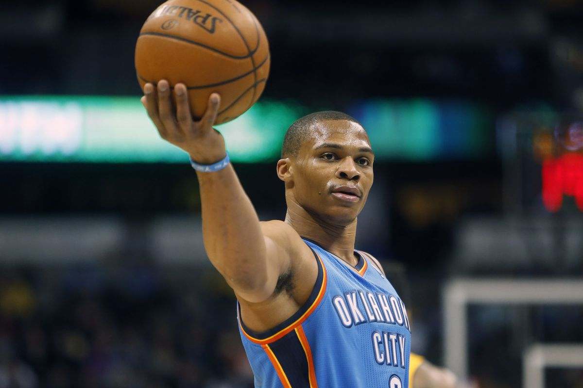 Thunder point guard Russell Westbrook holds out the basketball against Denver