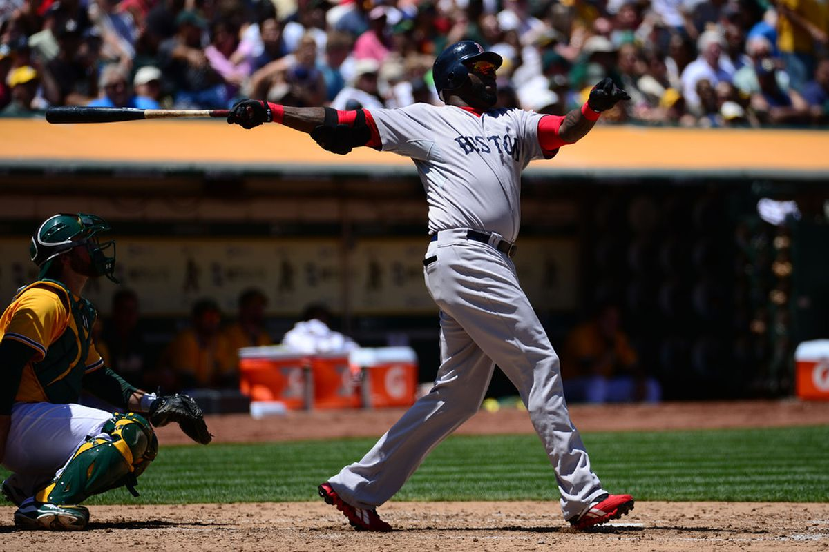 July 4, 2012; Oakland, CA, USA; Boston Red Sox designated hitter David Ortiz (34) hits his 400th career home run during the fourth inning against the Oakland Athletics at O.co Coliseum. Mandatory Credit: Kyle Terada-US PRESSWIRE