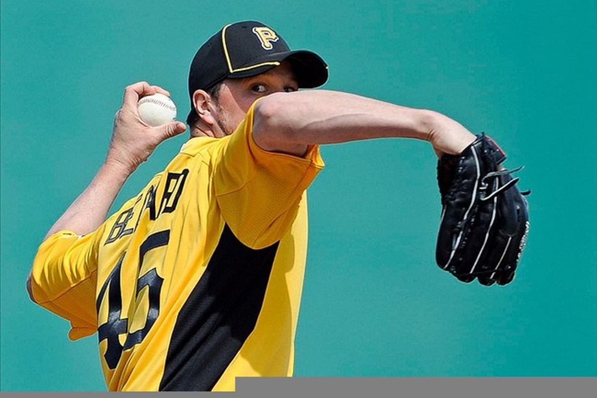 Mar 4, 2012; Bradenton, FL, USA; Pittsburgh Pirates starting pitcher Erik Bedard (45) pitches to the Toronto Blue Jays during the first inning at McKechnie Field. Mandatory Credit: Jerome Miron-US PRESSWIRE