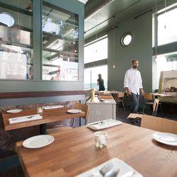 Chef Fred Sassen strolls through the dining room.